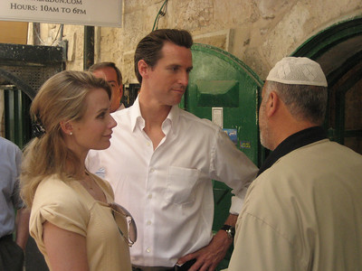 Mayor Newsom and his fiancee chat with an Arab antiquities dealer in the markets of the Old City.