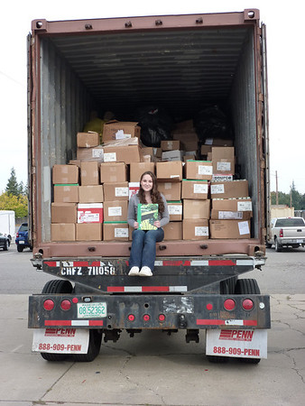 2011 Recipient Casey Robbins with textbooks bound for Liberia